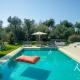 korfu-ferienhaus-luxusvilla-halikounas-Pool-Meerblick-sandstrand